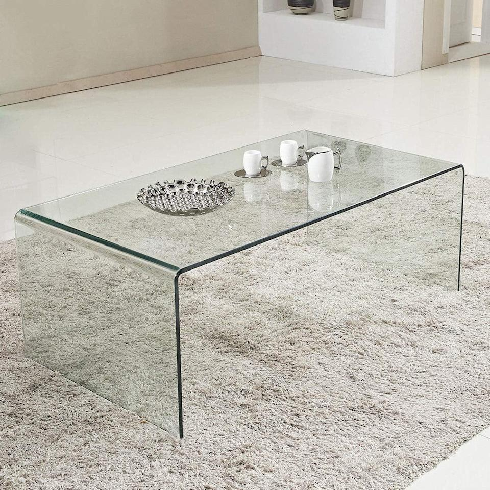 <p>Replace your old coffee table with this ultracool <span>Tangkula Glass Coffee Table</span> ($220), which will give the impression of a bigger space. It takes very little room, yet it will make your apartment look bigger.</p>