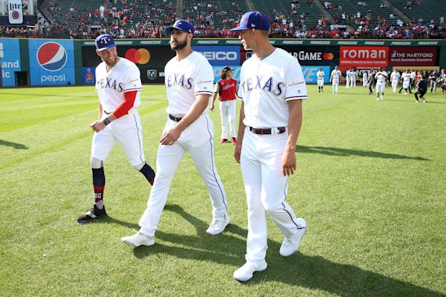 Hunter Pence #24 , Joey Gallo #13 and Mike Minor #23 of the Texas Rangers are seen on the field prior to the 90th MLB All-Star Game at Progressive Field on Tuesday, July 9, 2019 in Cleveland, Ohio. (Photo by Rob Tringali/MLB Photos via Getty Images)