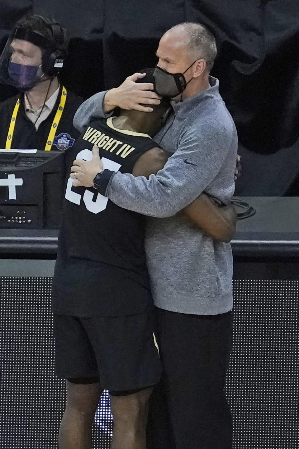 Colorado head coach Tad Boyle hugs McKinley Wright IV as he heads to the bench near the end of his teams 71-53 loss to Florida State during the second half of a second-round game in the NCAA college basketball tournament at Farmers Coliseum in Indianapolis, Monday, March 22, 2021. (AP Photo/Charles Rex Arbogast)
