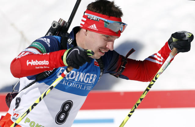 FILE - In this file photo dated Sunday, March 9, 2014, Russia's Evgeny Ustyugov competes in the men's 15km mass start at the biathlon World Cup competition in Pokljuka, Slovenia. The International Biathlon Union on Saturday Feb. 15, 2020, issued a two-year ban for Russia's Evgeny Ustyugov, who was part of the gold medal-winning mens relay team at the 2014 Sochi Winter Olympics. (AP Photo/Darko Bandic, FILE)