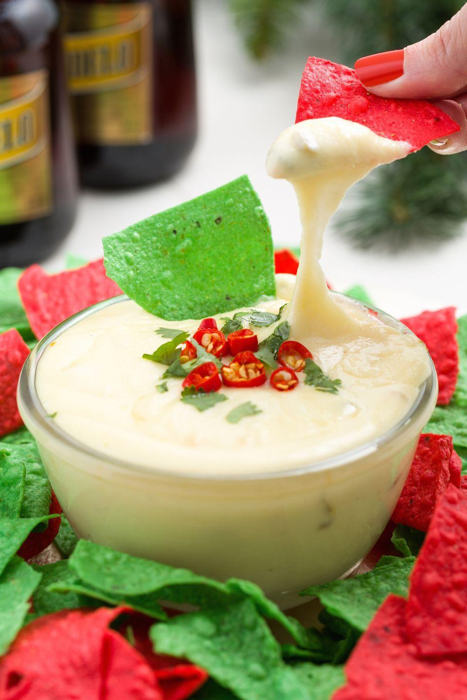 "<p>We're cheesing out over this pepper jack dip.</p><p>Get the recipe from <a href=""https://www.delish.com/cooking/recipe-ideas/recipes/a45172/christmas-queso-recipe/"" rel=""nofollow noopener"" target=""_blank"" data-ylk=""slk:Delish"" class=""link rapid-noclick-resp"">Delish</a>.</p>"
