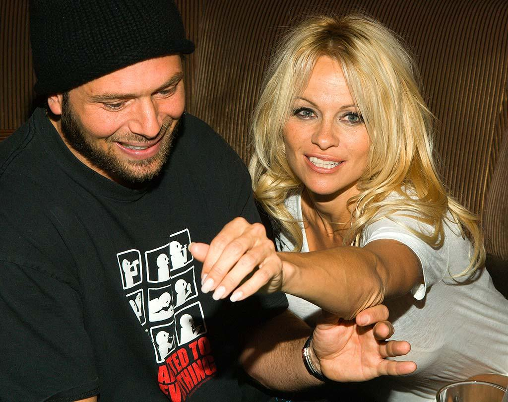 "Aside from starring roles in celebrity sex tapes, we're not quite sure what Pamela Anderson and Rick Salomon had in common prior to their October wedding in Las Vegas. Scott Doctor/<a href=""http://www.splashnewsonline.com"" target=""new"">Splash News</a> - October 11, 2007"