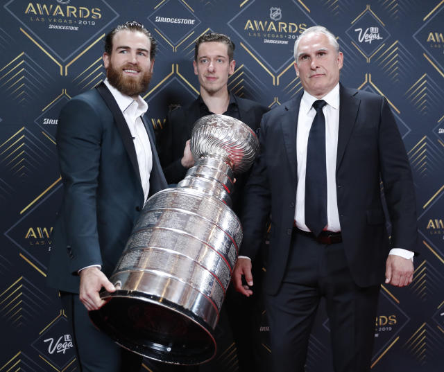From left, Ryan O'Reilly, Jordan Binnington and Craig Berube of the St. Louis Blues pose with the Stanley Cup on the red carpet before the NHL Awards, Wednesday, June 19, 2019, in Las Vegas. (AP Photo/John Locher)