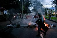 Demonstrators block a road in Medellin, Colombia on May 26, 2021