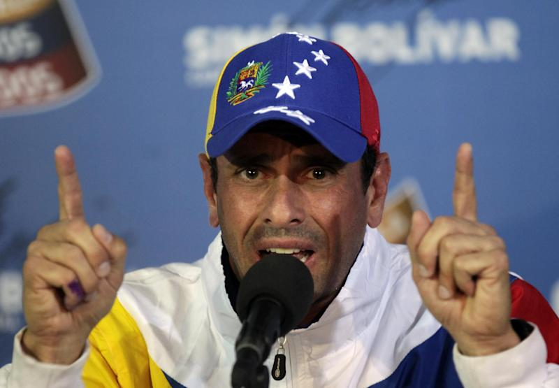 Opposition presidential candidate Henrique Capriles talks to journalists during a press conference at his campaign headquarters in Caracas, Venezuela, Tuesday, April 16, 2013. Capriles called off the planned opposition march in Caracas Wednesday demanding a vote-by-vote recount of Sunday's presidential election after President-elect Nicolas Maduro summoned his supporters to take to the streets in the capital, raising the possibility of a confrontation with anti-government protesters. (AP Photo/Ramon Espinosa)