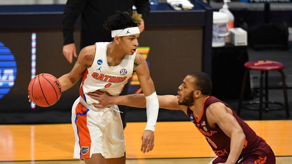 Tre Mann guarded by Virginia Tech guard during NCAA Tournament