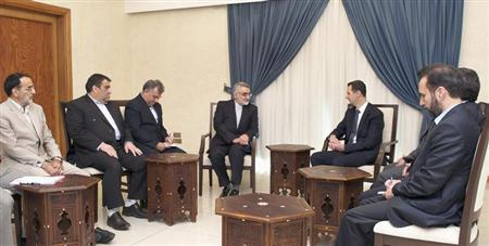 Syria's President Assad meets with Boroujerdi, head of the Iranian parliamentary committee for national security and foreign policy, in Damascus