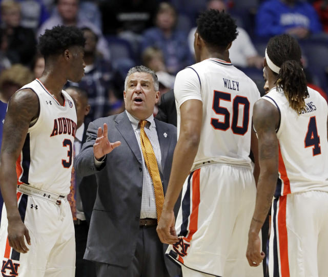 "Auburn will sit <a class=""link rapid-noclick-resp"" href=""/ncaab/players/136184/"" data-ylk=""slk:Danjel Purifoy"">Danjel Purifoy</a> and <a class=""link rapid-noclick-resp"" href=""/ncaab/players/140941/"" data-ylk=""slk:Austin Wiley"">Austin Wiley</a> indefinitely as a result of the FBI investigation. (AP)"