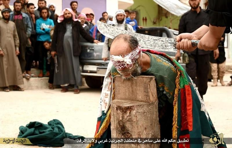 In this photo released on April 1, 2015, by a militant website, which has been verified and is consistent with other AP reporting, an Islamic State militant, not seen, right, holds a sword as he ready to beheads a Syrian magician, in Raqqa city, Syria. The Washington-based Syria Justice and Accountability Center, a U.S.-based Syrian rights group, said Thursday, Jan. 16, 2020,  that evidence, documents produced by the Islamic State militants themselves,  could help identify individuals responsible for atrocities during the militants four-year reign of terror in Syria, thus enabling prosecution for international crimes. (Militant website via AP)