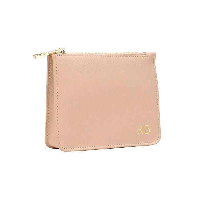 """Australian brand The Daily Edited has perfected understated (and affordable) monogramming. Add your initials to your new wallet free of charge. $50, The Daily Edited. <a href=""""https://www.thedailyedited.com/taupe-mini-structured-pouch"""" rel=""""nofollow noopener"""" target=""""_blank"""" data-ylk=""""slk:Get it now!"""" class=""""link rapid-noclick-resp"""">Get it now!</a>"""