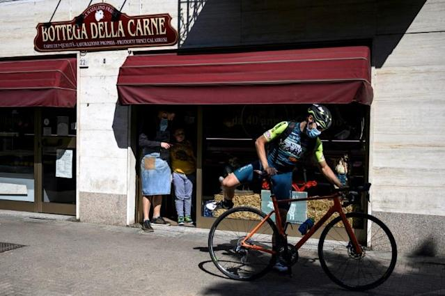 After the lockdown, Marengo got in touch with Turin's mayor and was soon speeding along abandoned city streets on his racing bike (AFP Photo/MARCO BERTORELLO)