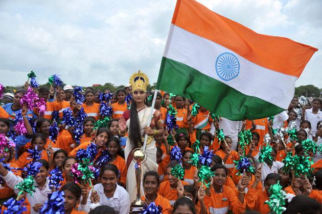 An Indian woman dressed as Bharath Matha (Mother of India) poses with a tricolour flag during India's Independence Day celebrations in Secunderabad, the twin city of Hyderabad, on August 15, 2012. Manmohan Singh used his Independence Day speech to promise to improve conditions for foreign investment in the country after a sharp downturn in economic growth.  AFP PHOTO / Noah SEELAM