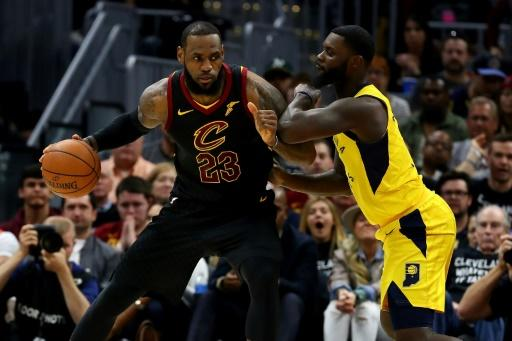 LeBron James of the Cleveland Cavaliers (L) tries to get around Lance Stephenson of the Indiana Pacers