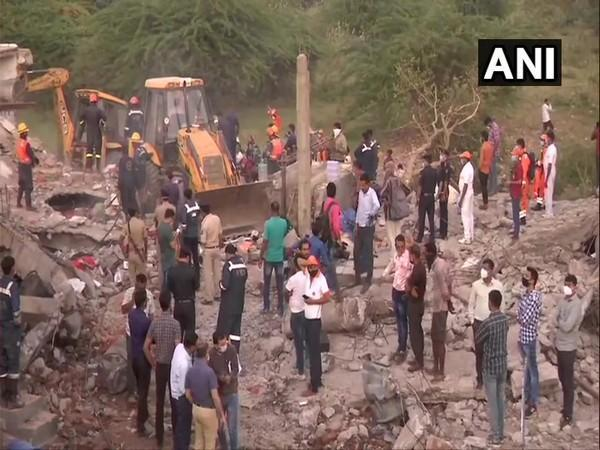 Rescue operation is underway at the godown in Ahmedabad. Photo/ANI