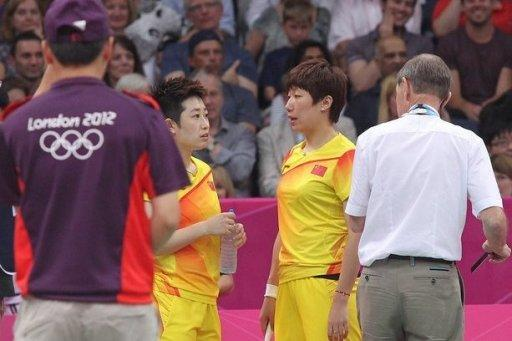 Badminton World Federation (BWF) referee Torsten Berg (R) alerts China's Yu Yang (2nd L) and Wang Xioli during their women's double badminton match against South Korea's Jung Kyun Eun and Kim Ha Na to play fairly at the London 2012 Olympic Games. Both pairs were later disqualified due to their conduct
