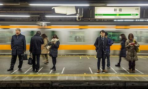 Passengers tend to queue on the platform before entering trains (look out for floor markings) - Credit: getty