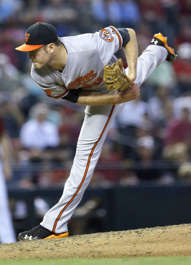 Baltimore Orioles' Chris Tillman delivers a pitch against the Arizona Diamondbacks during the sixth inning of a baseball game, Wednesday, Aug. 14, 2013, in Phoenix. (AP Photo/Matt York)