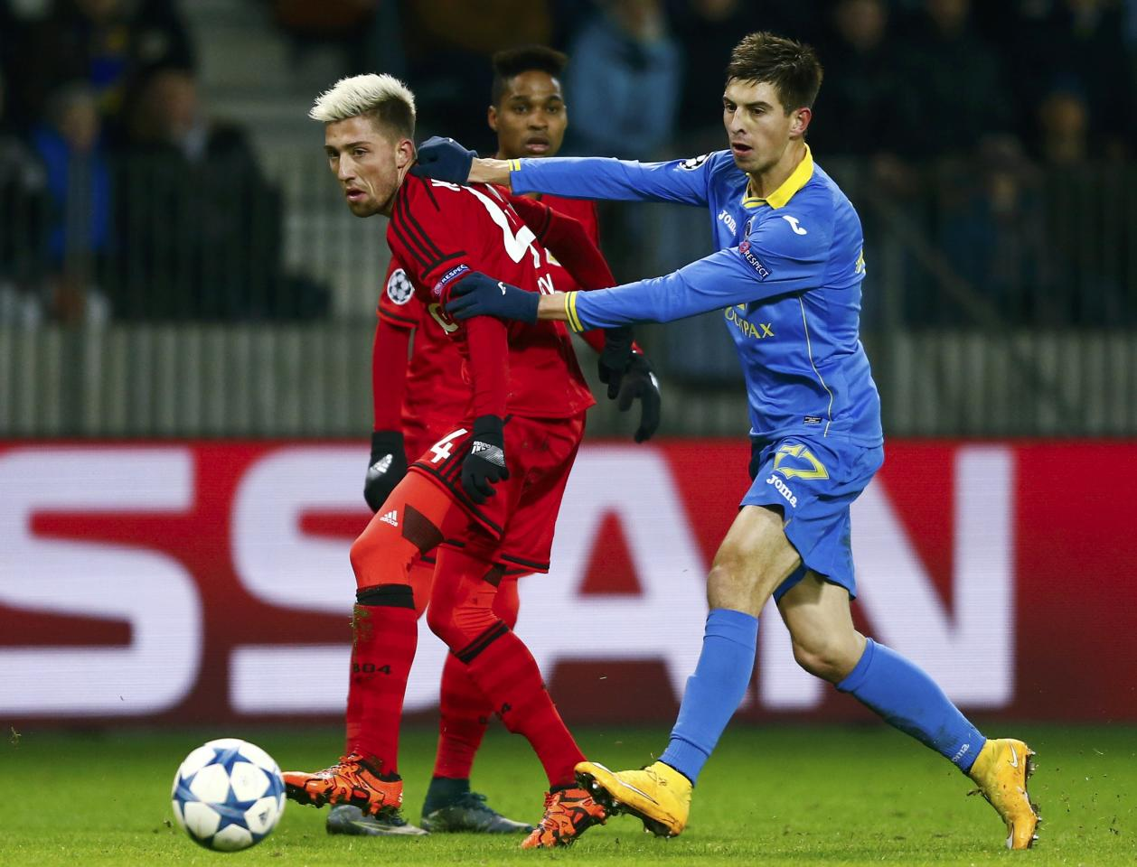 Football Soccer - BATE Borisov v Bayer Leverkusen - Champions League Group Stage - Group E -  Borisov Arena, Borisov, Belarus - 24/11/2015  BATE Borisov's Aleksei Rios in action against Bayer Leverkusen's Jonathan Tah REUTERS/Vasily Fedosenko