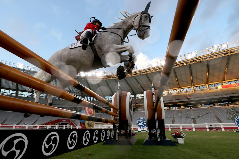 <p>Haydy Morsy of Team Egypt riding Aerosmith competes in the Riding Show Jumping of the Women's Modern Pentathlon on day fourteen of the Tokyo 2020 Olympic Games at Tokyo Stadium on August 06, 2021 in Chofu, Japan. (Photo by Dan Mullan/Getty Images)</p>