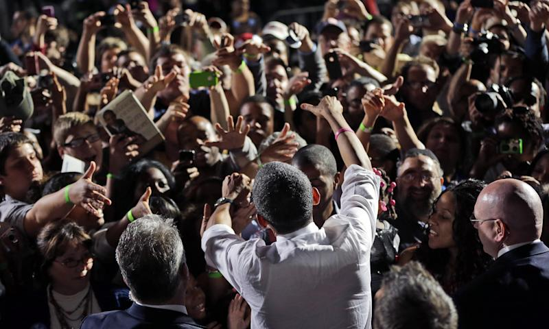 President Barack Obama greets supporters after speaking at a campaign event at Cleveland Burke Lakefront Airport, Thursday, Oct. 25, 2012, in Cleveland. (AP Photo/Pablo Martinez Monsivais)
