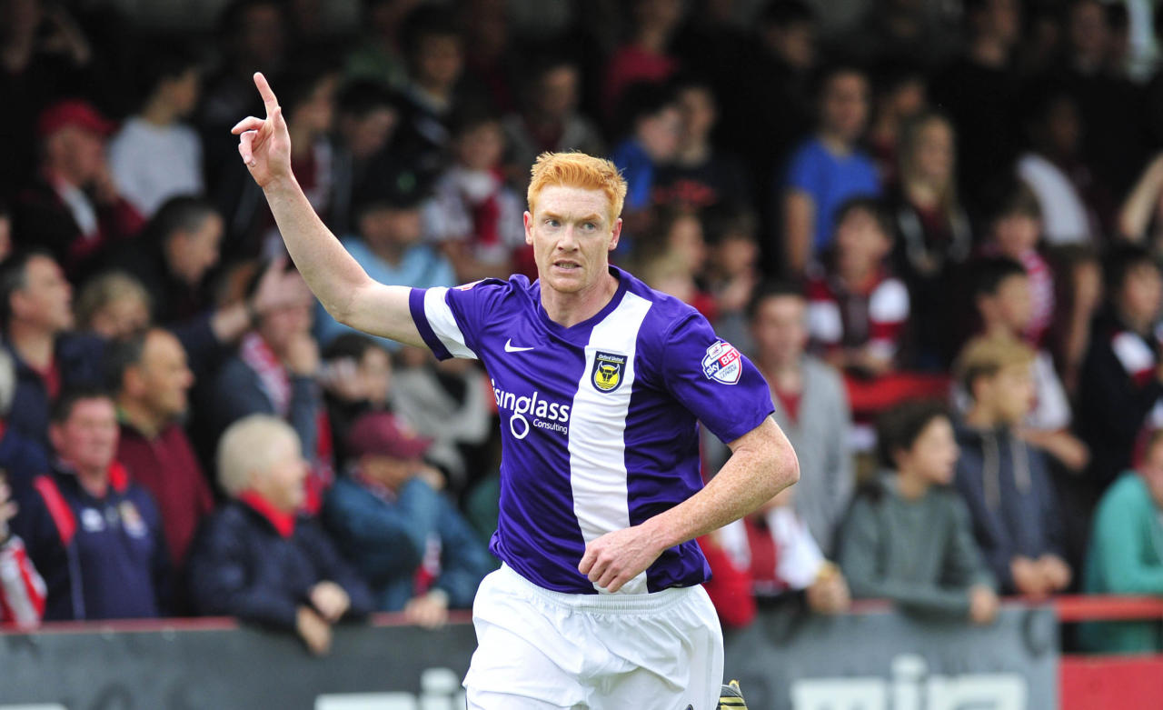 Oxford's David Kitson celebrates his goal during the Sky Bet League Two match at the Abbey Business Stadium, Cheltenham.