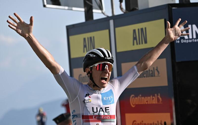 Stage winner Team Jumbo rider Team UAE Emirates rider Slovenias Tadej Pogacar celebrates as he crosses the finish line at the Grand Colombier pass during the 15th stage of the 107th edition of the Tour de France cycling race 175 km between Lyon and Grand Colombier on September 13 2020 Photo by AnneChristine POUJOULAT POOL AFP Photo by ANNECHRISTINE POUJOULATPOOLAFP via Getty Images