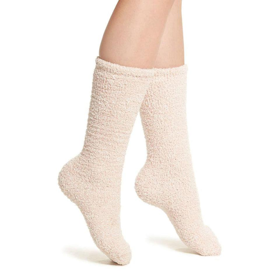 """<p><strong>Barefoot Dreams</strong></p><p>nordstrom.com</p><p><strong>$15.00</strong></p><p><a href=""""https://go.redirectingat.com?id=74968X1596630&url=https%3A%2F%2Fwww.nordstrom.com%2Fs%2Fbarefoot-dreams-cozychic-socks%2F5583640&sref=https%3A%2F%2Fwww.prevention.com%2Flife%2Fg29518657%2Fgifts-for-teenage-girls%2F"""" rel=""""nofollow noopener"""" target=""""_blank"""" data-ylk=""""slk:Shop Now"""" class=""""link rapid-noclick-resp"""">Shop Now</a></p><p>Barefoot Dreams sells high-quality knit blankets that are unbelievably soft and make the perfect mainstay on your couch. These socks are made of the same material as the <a href=""""https://go.redirectingat.com?id=74968X1596630&url=https%3A%2F%2Fwww.nordstrom.com%2Fs%2Fbarefoot-dreams-cozychic-ribbed-throw-blanket%2F3189579&sref=https%3A%2F%2Fwww.prevention.com%2Flife%2Fg29518657%2Fgifts-for-teenage-girls%2F"""" rel=""""nofollow noopener"""" target=""""_blank"""" data-ylk=""""slk:best-selling throw"""" class=""""link rapid-noclick-resp"""">best-selling throw</a> to keep feet wrapped in warmth on the coldest of nights. </p>"""