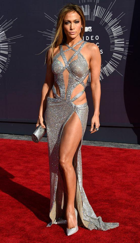 <p>This perennial Fly Girl knows how to show off her body (tropical-print Versace dress, anyone?) and gave her leg and toned tummy the spotlight at the 2014 MTV VMAs. The smoldering stare was a bonus. (Photo: Getty Images) </p>