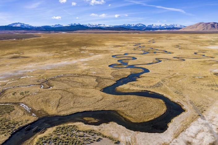 MAMMOTH LAKES, CA - JANUARY 13: The Owens River flows through wetlands and pastures near Benton Crossing on Wednesday, Jan. 13, 2021 in Mammoth Lakes, CA. For seven decades, LADWP has provided free allotments of water for irrigation purposes in the area and now they want to send the water south to Los Angeles instead. (Brian van der Brug / Los Angeles Times)