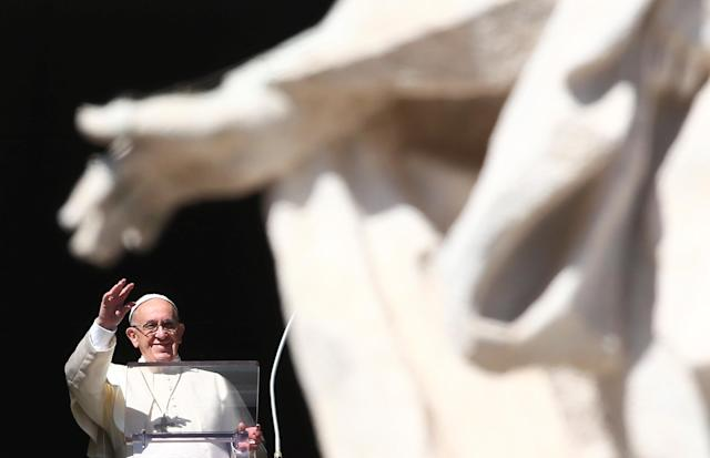 <p>Pope Francis waves during his Angelus prayer on All Saints' Day in Saint Peter's Square at the Vatican, Nov. 1, 2017. (Photo: Alessandro Bianchi/Reuters) </p>