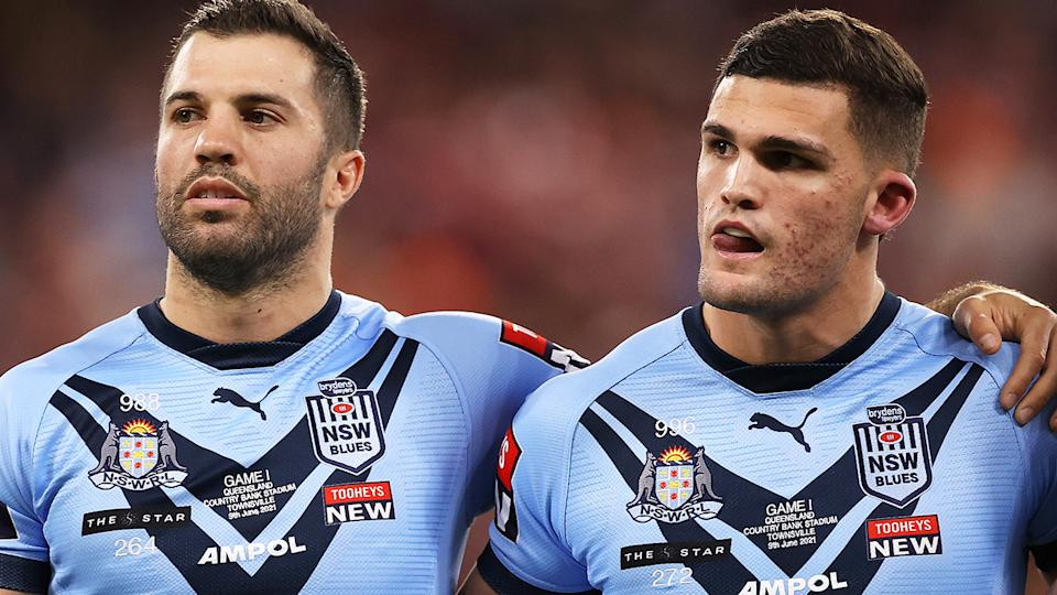 NSW Blues players James Tedesco and Nathan Cleary watch the national anthem before State of Origin I.