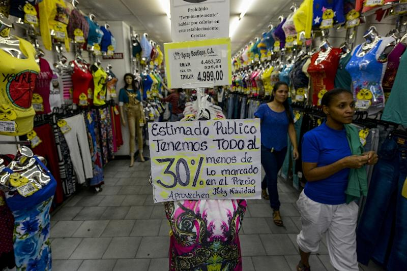 Venezuelan government has ordered the owners of shops selling clothing, footwear and accessories to reduce their prices by 30% during Christmas period (AFP Photo/FEDERICO PARRA)