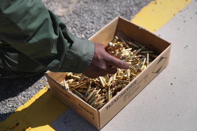 <p>A U.S. Border Patrol trainee grabs a handful of bullets before loading his magazine at a weapons training class at the U.S. Border Patrol Academy on August 3, 2017 in Artesia, N.M. (Photo: John Moore/Getty Images) </p>
