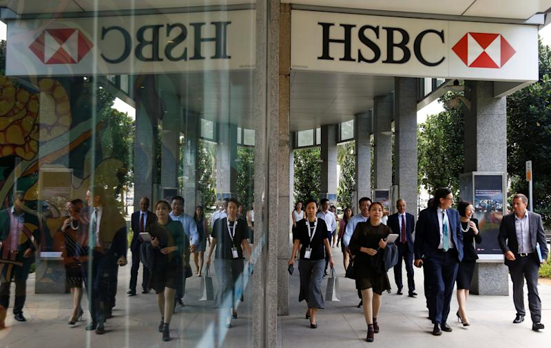 People walk past a HSBC signage in Singapore October 8 2019. REUTERS/Feline Lim