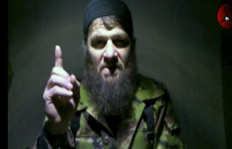 """FILE - This is a file image taken from video and released Monday, Feb. 7, 2011 by The Kavkaz Center, a website affiliated with Chechen rebels, of insurgent leader Doku Umarov speaking in a video. An Islamic militant group in Russia's North Caucasus is reporting the death of Doku Umarov its leader, who had threatened to attack Sochi Olympics and was one of Russia's most wanted men. The Caucasus Emirate announced the """"martyrdom"""" of Umarov in a statement posted Tuesday on the website of Kavkaz Center, which serves as a mouthpiece for Islamic militant groups. No cause was given. (AP Photo/The Kavkaz Center, File) NO SALES"""