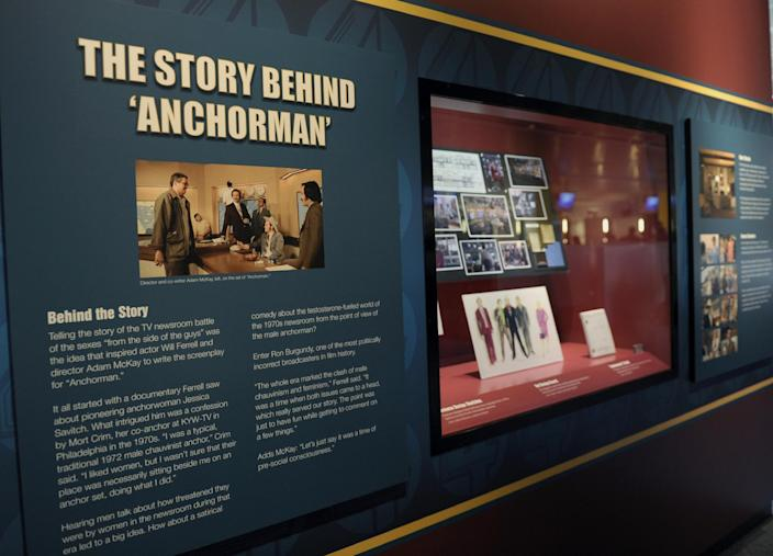 """Information about the """"Anchorman"""" movie are seen at an exhibit at the Newseum in Washington, Friday, Nov. 15, 2013. The museum about news and the First Amendment has opened """"Anchorman: The Exhibit,"""" featuring costumes and props from Will Ferrell's 2004 movie """"Anchorman: The Legend of Ron Burgundy."""" The story of a fictional news team's sexist reaction to the arrival of an ambitious female reporter was a parody of real tumult in the 1970s TV business. (AP Photo/Susan Walsh)"""