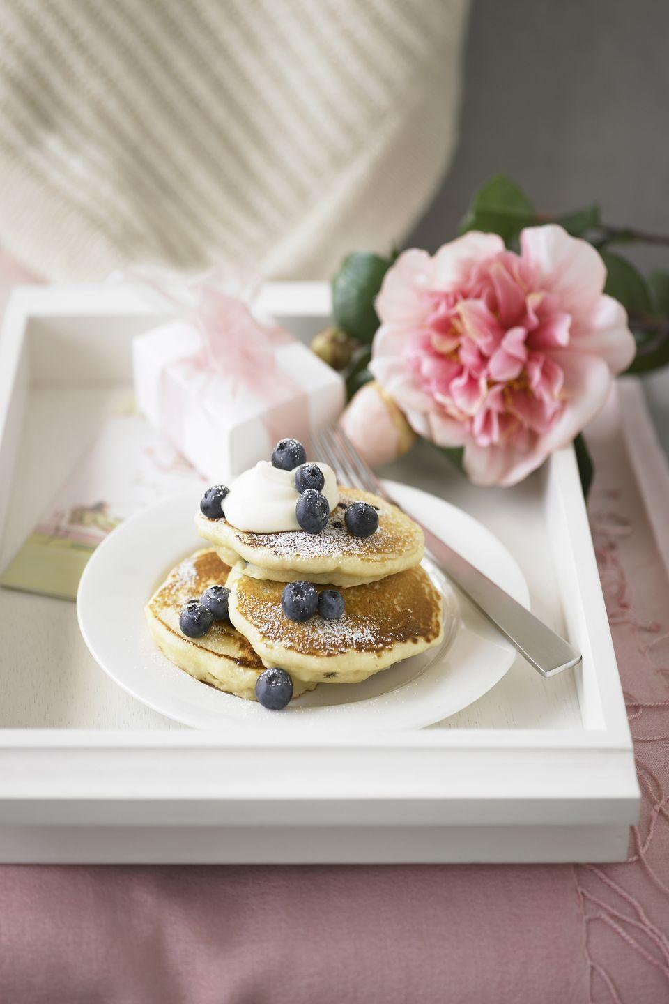 "<p>Start off Mom's special day by ordering up a tray full of her favorite breakfast goodies and having them delivered right to her bed. <br></p><p><strong><a href=""https://www.countryliving.com/food-drinks/g1681/mothers-day-breakfast-in-bed/"" rel=""nofollow noopener"" target=""_blank"" data-ylk=""slk:Or make our best Mother's Day breakfast-in-bed recipes."" class=""link rapid-noclick-resp"">Or make our best Mother's Day breakfast-in-bed recipes.</a></strong></p>"
