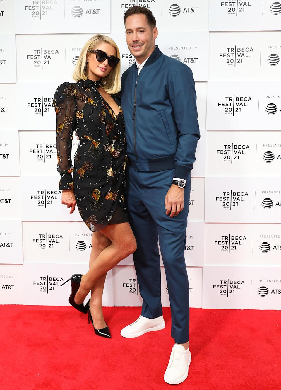 <p>Paris Hilton pops her foot while joining fiancé Carter Reum at the Tribeca Film Festival premiere of her documentary <em>This Is Paris</em> in N.Y.C. on June 20.</p>