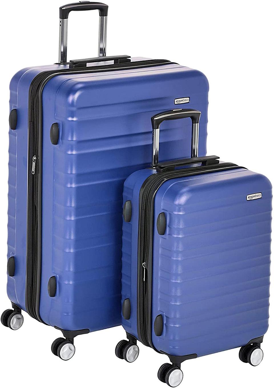 <p>If you're going for a longer change of scenery after being cooped up in the same place for over a year, you might be seeking something more than a carry-on. This hardshell Amazon Basics set is literally two suitcases for the price of one, so you'll have plenty of room for extra essentials — or a few more outfit changes!</p>