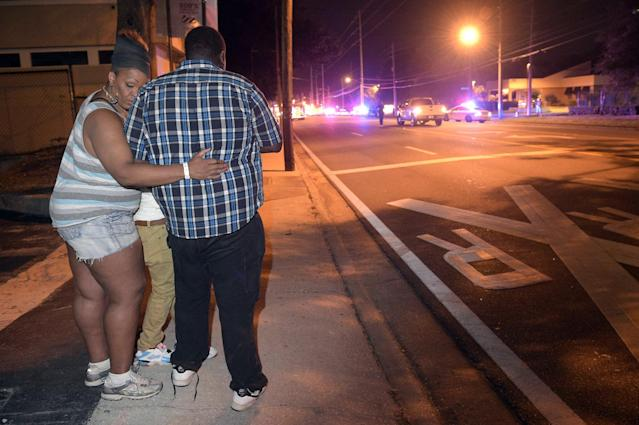 <p>Bystanders wait down the street from a multiple shooting at the Pulse nightclub in Orlando, Fla.,June 12, 2016. (AP Photo/Phelan M. Ebenhack) </p>