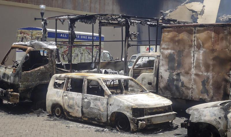 This photo taken Saturday, Sept. 28, 2013 and made available Monday, Sept. 30, 2013, shows burnt vehicles outside the Westgate Mall in Nairobi, Kenya. The four-day siege, which included the collapse of part of the mall, left 67 people dead, according to officials. (AP Photo)