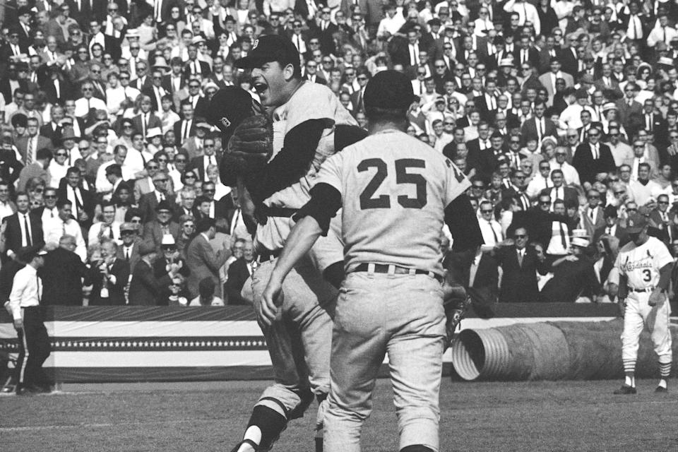"""FILE - Detroit Tigers catcher Bill Freehan lifts pitcher Mickey Lolich off his feet as he screams with joy after defeating the St. Louis Cardinals 4-1 in the final game of the World Series in St. Louis, in this Thursday, Oct. 11, 1968, file photo. Joining the celebration is Norm Cash (25). Freehan, an 11-time All-Star catcher with the Detroit Tigers and key player on the 1968 World Series championship team, has died at age 79. """"It's with a heavy heart that all of us with the Detroit Tigers extend our condolences to the friends and family of Bill Freehan,"""" the team said Thursday, Aug. 19, 2021. (AP Photo)"""