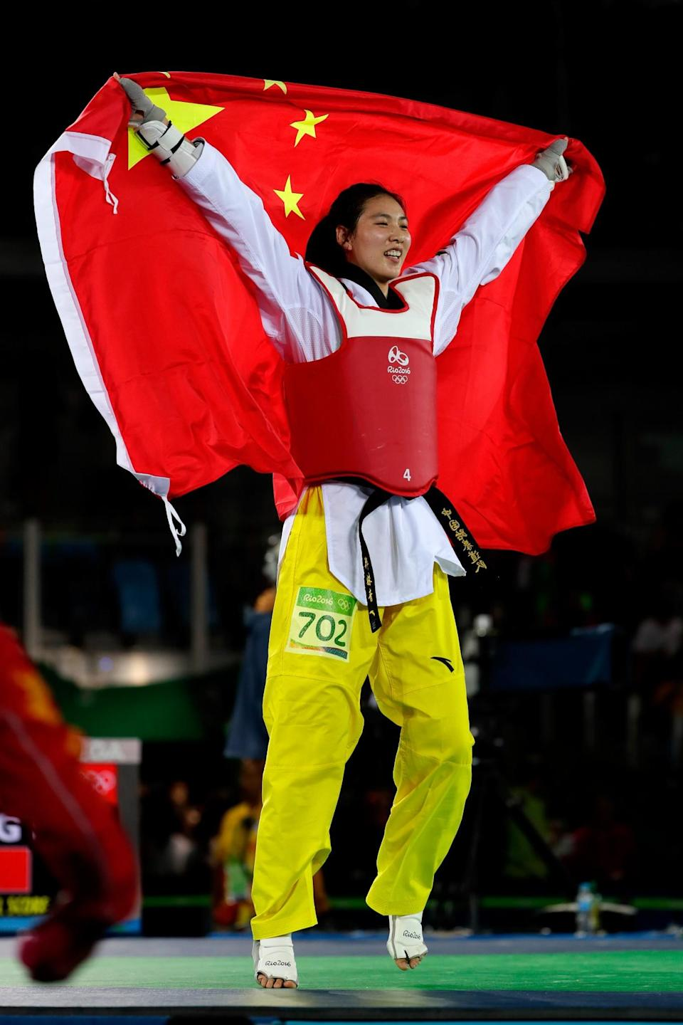 <p>Shuyin Zheng of China celebrates beating Maria del Rosario Espinoza Espinoza of Mexico during the Taekwondo Women +67kg Gold Medal Contest on Day 15 of the Rio 2016 Olympic Games at Carioca Arena 3 on August 20, 2016 in Rio de Janeiro, Brazil. (Photo by Jamie Squire/Getty Images) </p>