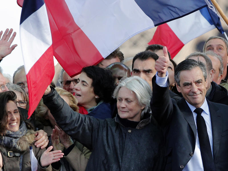 François Fillon, next to his wife Penelope, speaks at a rally in Paris on Sunday: AP/Christophe Ena