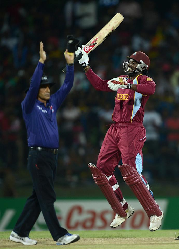 KANDY, SRI LANKA - OCTOBER 01:  Chris Gayle of the West Indies celebrates winning the superover to win the ICC World Twenty20 2012 Super Eights Group 1 match between the West Indies and New Zealand at Pallekele Cricket Stadium on October 1, 2012 in Kandy, Sri Lanka.  (Photo by Gareth Copley/Getty Images)