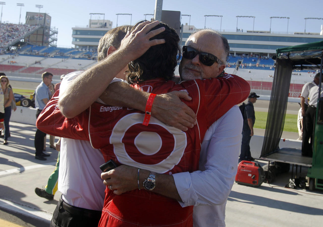Dario Franchitti, of Scotland, returns to pit row following tribute laps in honor of Dan Wheldon, who was killed earlier in a crash during the IndyCar Series' Las Vegas Indy 300 auto race on Sunday, Oct. 16, 2011, in Las Vegas. (AP Photo/Isaac Brekken)