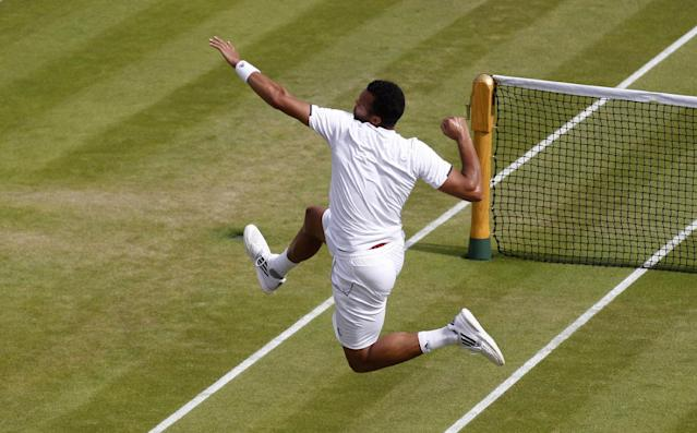 Jo-Wilfried Tsonga of France celebrates after defeating Sam Querrey of the U.S. in their men's singles match at the All England Lawn Tennis Championships in Wimbledon, London, Thursday, June 26, 2014. (AP Photo/Sang Tan)