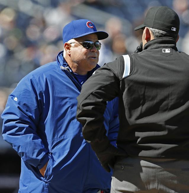 Chicago Cubs manager Rick Renteria challenges a force play at first by asking for a video review from first base umpire Manny Gonzalez in the seventh inning of Game 1 of an interleague baseball doubleheader at Yankee Stadium in New York, Wednesday, April 16, 2014. The Cubs runner was ruled out after the review. (AP Photo/Kathy Willens)