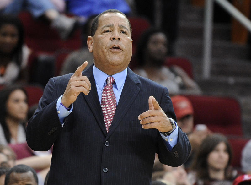 "In this Nov. 10, 2012, photo, Houston Rockets assistant coach Kelvin Sampson talks to players during their NBA basketball game against the Denver Nuggets in Houston. The NCAA hit Sampson with a five-year ""show-cause"" order after Sampson was a college coach at Oklahoma and Indiana, for improper calls to recruits. Sampson resigned at Indiana. (AP Photo/Pat Sullivan)"