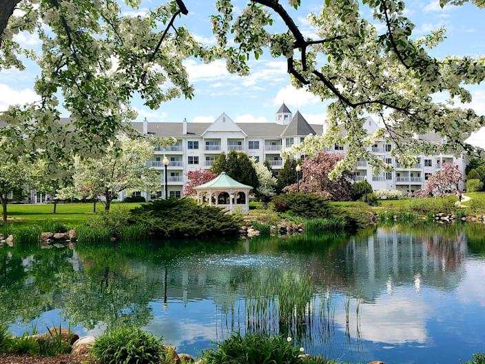 """<p><strong>Best for:</strong> Families in search of calm waters</p> <p>Created by glaciers more than 10,000 years ago, Southeastern Wisconsin's Elkhart Lake is known for its crystal clear water and sandy shores. The lakefront <a href=""""https://cna.st/affiliate-link/2vVaxY1iVx9a9PKxWzXaSbvuJBcFXoMWLwRMm3v1GR3R6adGY6qT7Zf58jEbidZLXN?cid=6073699bd1058698d13c31c7"""" rel=""""nofollow noopener"""" target=""""_blank"""" data-ylk=""""slk:Osthoff Resort"""" class=""""link rapid-noclick-resp"""">Osthoff Resort</a> has countless ways to take advantage of those clear, tranquil waters. Beyond swimming, there's kayaking, sailing, Hydro-biking, and more. During the summertime, kids ages four to 10 can enroll in the Pleasures Program for supervised fun, including ice cream making and scavenger hunts. Gather as a family for lawn games, a lake cruise tour, volleyball games, and beach bonfires. </p> <p><strong>Book now:</strong> <a href=""""https://cna.st/affiliate-link/6sRFZT3uQfV4bZmht1L2v1Yt6CrL8EsLYfvKyc9HnY61UnXF17z42cFQFn7X7xC9W4nbVjMkUZXwgVvnoSEhttGHnTLE7XheXUWHpT1uSrQav4U5oPBjUHQDUaAPYHXTNeq3GaPuv1Zf3RqJhF9vss9NzsPDqP67EmkGmQF1Ltg7FZ9mfi7qoDM6rBS9XR?cid=6073699bd1058698d13c31c7"""" rel=""""nofollow noopener"""" target=""""_blank"""" data-ylk=""""slk:From $255 per night, tripadvisor.com"""" class=""""link rapid-noclick-resp"""">From $255 per night, tripadvisor.com</a></p>"""